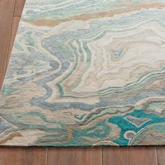 Employ the incomparable beauty of nature to create a can-miss focal point with our Abstract Swirl Area Rug. Bring your most prominent spaces alive with colorful conversation. Enlarged imagery of natural agate, rendered in impeccable detail, is a dynamic spectacle for the eyes. Kick off your shoes, and you see it just as heavenly for the feet. A deep, rich blend of wool and art silk you indulge in, barefoot, at every opportunity. Masterfully crafted by expert artisans, place this rug center…