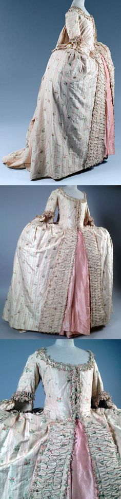 Robe à la française sur grand panier en Pékin façonné, c.1760.  Striped with flowers brocaded silk taffeta on cream background. Fine pleated flounces highlighted with a pink ruffle. Bodice with pagoda sleeves.