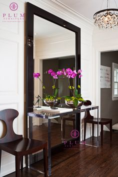 love the idea of a huge mirror tucked behind the console table in the foyer