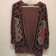Aztec cardigan 3/4 sleeve Aztec cardigan is very cute and very warm. Pair it with leggings, some boots and even a scarf and you have the perfect outfit! Cotton Emporium  Sweaters Cardigans