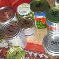 """Once upon a time I thought there wasn't much to know about storing canned goods on the boat. Then we had a """"boisterous"""" sail around Cabo Corrientes and it became obvious that what had worked in calm waters wasn't going to work when we were living life on a heel!  Tips from TheBoatGalley.com"""