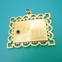 July 7 14k Gold Charm Pendant- Vintage, via Etsy.