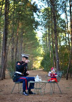 A Marine and his daughter having tea!