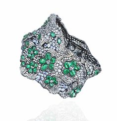 Ann Lin Les Sakura Bracelet in white gold with diamonds and emeralds, from the Opera Collection.