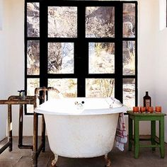dream bathroom.  I love the old bathtub, the mix of colors: black, white and green.