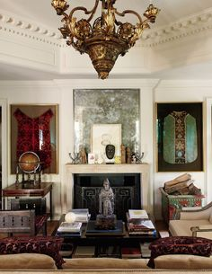 Past Perfect Richard Shapiro - An antique French stone fireplace is flanked by framed 16th century Italian clerical vestments. Personal mementos and acquisitions add layers of visual interest and idiosyncratic significance to the mantel.
