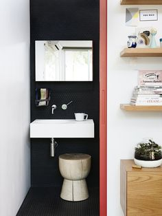 What a terrific space. The matte black penny tile with black grout is super; also loving the red pocket door. What a terrific space. The matte black penny tile with… Bathroom Interior, Modern Bathroom, Small Bathroom, Bathroom Black, Bathroom Trends, Minimalist Bathroom, Bathroom Ideas, Tiny Bathrooms, Bathroom Remodeling