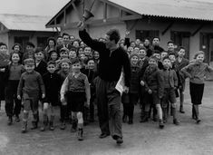 Kindertransport: A desperate effort to save children from the Holocaust | Jan. 11, 1939 A camp leader rings the dinner bell for refugees at the Dovercourt holiday camp. IMAGE: REG SPELLER/FOX PHOTOS/GETTY IMAGES