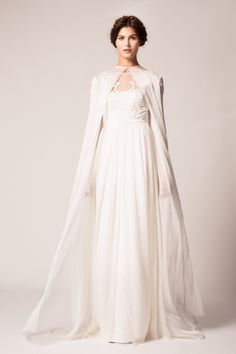 Top 10 Bridal Trends for 2015 ---  Coats, Capes & Coverlets  There is so much to love about this trend (which is possibly why 2015 will be the second year for this key look) Capes create a bold statement, a demure look, a unique silhouette and better still, removing one gives you a completely new look for the reception without the expense of a second dress! What could be more perfect than that?…..