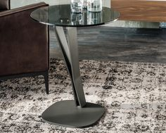 Designer side table from Cattelan Italia with base in graphite embossed steel with a clear or smoked glass top.