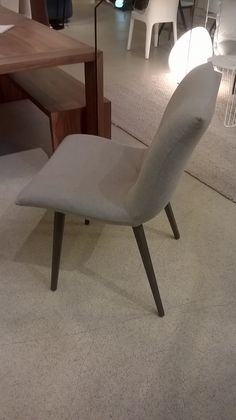 Single Calin dining or desk chair in Oda fabric in a silver-grey with grey wood…