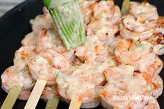 Bangin' Grilled Shrimp Skewers Ingredients: 2 1/2 tbsp light mayonnaise 2 tbsp scallions, chopped fine 1 1/2 tbsp Thai Sweet Chili Sauce 1/2 tsp Sriracha (or to taste) Season and Cook Shrimp.  Then coat with sauce