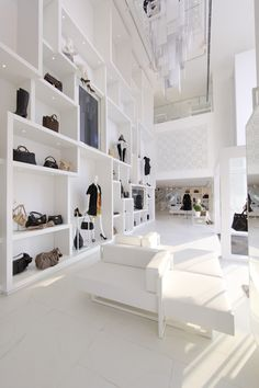 Picture A: Flexible, moveable shelving system. Layout, not look. Not white, black framed open shelving, wooden shelves. Areas 1  2.