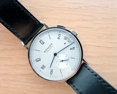 """We love the immense beauty found in the Nomos' simple design  What makes NOMOS special is the attention to detail on the dial and other parts. In particular, the cream dial has simply printed hour markings with a NOMOS """"unique"""" sans serif font. The cutout for the GMT is done in layer, brilliantly executed, giving a sense of depth to the dial.  http://www.ablogtowatch.com/nomos-tangomat-gmt-review/?utm_source=feedburner_medium=email_campaign=Feed%3A+Ablogtowatch+%28ABLOGTOWATCH%29"""