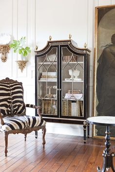 Vignette ~ Armoire paired with a zebra print arm chair.....LOVE THE ARMOIRE