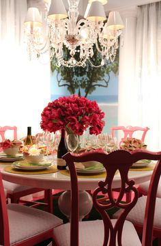 love the idea of taking traditional [boring] wooden chairs and painting them a bold, fresh color-!