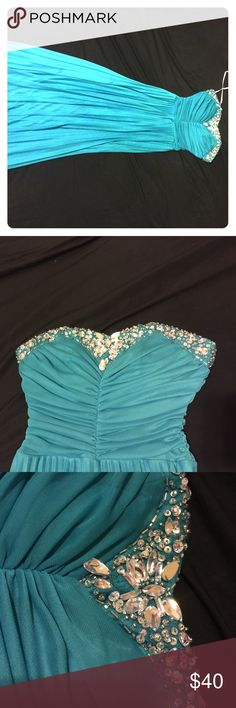Long homecoming/ prom formal dress Beautiful sweetheart teal dress with jewel embezzlement on top. Only worn once . Middle jewel broken but easily fixed. Otherwise in great condition Dresses Strapless