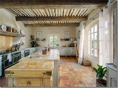 Tile Floor Beamed ceiling.
