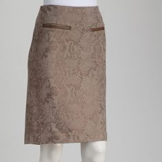 w/ tags! Luxe Lined Skirt NWT, never worn: Amanda + Chelsea: Atelier ponte skirt, size 12.                                                                        Creamy caramel color- a true modern nude- subdued snakeskin print, vegan leather details. Just above the knee in length.                                  57% viscose, 39% nylon, 4% spandex.                      Imported. Thick material! Amanda + Chelsea Skirts