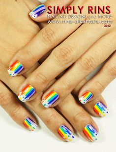 This Dripping Rainbow nail design is cheerful. Perfect for summer!
