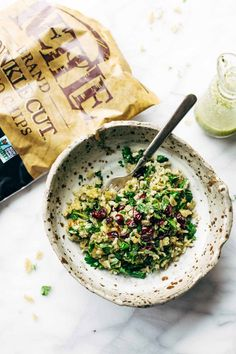 Garlic Kale and Brown Rice Salad with a zippy lemon herb dressing! This side dish recipe is so simple and it compliments almost any main dish! Vegetarian, vegan. | pinchofyum.com