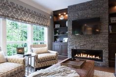 Elegance fireplace in the interior living room with tv wall mount above as well bookcase idea on the wall plus gray floral shades window