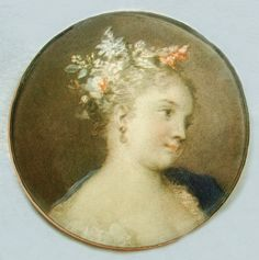 Vintage glass watch crystal button with a lovely painting of a woman.