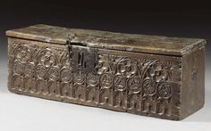 A RARE BOARDED CHEST, GOTHIC, 15TH/16TH CENTURY  oak, the front carved with blind tracery, quatrefoils and roundels, the sides with traces of former carrying handles  h.38.5cm., w.113cm., d.41cm.