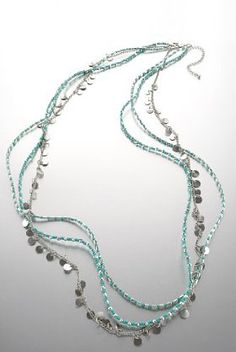 Get funky with this Limited Collection multi row disc necklace.