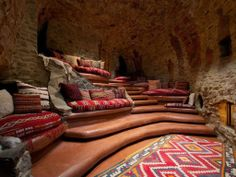 Relax in the cave! Tiered terracotta seating lends this home theater a Southwestern vibe.