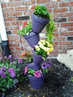 My mom dicided to be crafty and make this adorable flower pot stack. She used terra cata pots and spray painted them. Bought a few different kinds of flowers. She also got a rod to stick in all of the holes of the pots and into the ground. My mom did a pretty good job :)