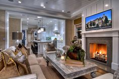 501 Carnation - traditional - family room - orange county - Spinnaker Development. Love coffee table, television and fireplace treatment. Kitchen arch leads directly in like at Remington