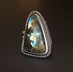 A massive spectrolite cocktail ring make quite a statement!