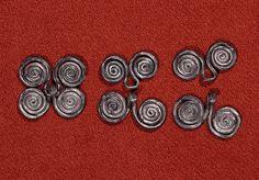 Hektespenner av bronse