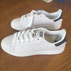 b04f78675fb677 Stan Smith Sneakers Brand new Stan Smith white sneakers with navy blue  accent. Size runs