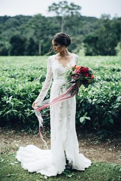 lacy wedding dress - photo by Figtree Pictures http://ruffledblog.com/moody-industrial-wedding-inspiration
