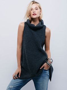 Need It Now Tank | Chunky knit sleeveless sweater featuring a cowl neck and dropped armholes.  High, open slit in back.