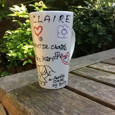 Hot Chocolate/Latte mug simply created with the children's drawings in biro, then gone over by me with black pottery paint using a writer bottle, glazed and fired for a permanent finish