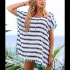 """Striped Beach Cover Up w/Tassels This is really gorgeous! It's super lightweight and packable, making it perfect for your next tropical getaway Somewhat sheer. 100% polyester. It's black and white stripes with bright sea foam green tassel detail. Measures 31"""" from top of shoulder to bottom of tassels. Measures 27"""" armpit to armpit. 12"""" arm hole opening. You will love this cover up Since it is retail, it comes in it's original packaging. Swim Coverups"""