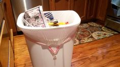Attach a Command Strip to hold your garbage bag in place!