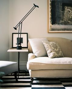 Living Room Photo - A natural sofa with a black-and-white-striped rug