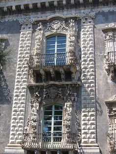 Sicilian Baroque style University of Catania rusticated pilasters against a smooth background.