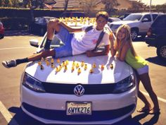 """Asking a girl to homecoming """"I'd be one lucky ducky if you went to Homecoming with me"""" on poster (ducks all over car when she walks out) with sunflowers to go with the yellow theme.  Heather Hopkins"""