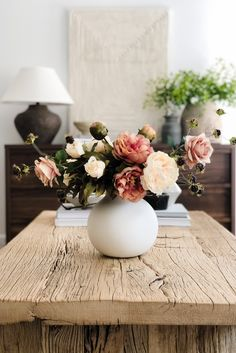 Create a simple, stunning fall floral centerpiece arrangement with faux peony stems, wild raspberries, and artificial roses. Style in a neutral ceramic vase and enjoy a simple fall refresh for your transitional home decor. Shop this look by @beauxarts107 at Afloral.com.