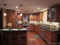 Cliqstudios.com Carlton cabinets in Maple Caramel look fantastic in this kitchen remodel. Can you believe the homeowners did it all themselves? Nice job!