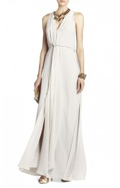 $198.00 hassle shipping and returns. Receive free shipping and free returns on all bridal and bridesmaid styles.   Glide through the crowd in this effortlessly breezy and Bohemian halter dress. V-neck halter. Sleeveless.Slight contrast at neckline and draped front detail. Cinched waist.Georgette: Polyester. Chiffon: Silk.Dry Clean.Imported.