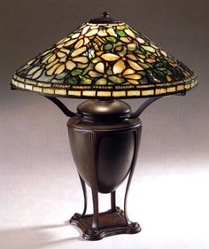 """Tiffany Studios, New York, Favrile Leaded Glass and Patinated Bronze """"Clematis"""" Lamp."""