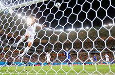 Phil Jagielka of England heads the ball off the line during the 2014 FIFA World Cup Brazil Group D match between England and Italy at Arena Amazonia on June 14, 2014 in Manaus, Brazil.