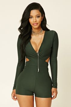 A soft knit bodysuit featuring a surplice front, back and waist cutouts, long sleeves, and an elasticized waist.