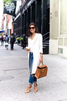 Kat Tanita is looking totally glam in this bright white overcoat, worn with a simple white V neck tee and a pair of distressed jeans. Choosing tan accessories and a pair of matching sandals will allow you to steal Kat's style exactly. Coat: Maje, Jeans: Rag & Bone, Bag: Hermes, Heels: Brian Atwood.